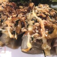 Rouleaux d'endives Perle du Nord au lard fumé, oignons et fromages